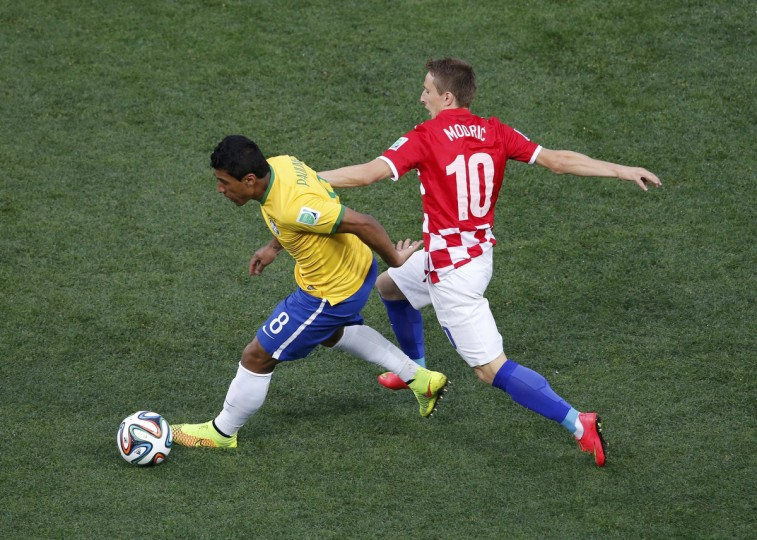 Brazil's Paulinho (L) fights for the ball with Croatia's Luka Modric during the 2014 World Cup opening match between Brazil and Croatia at the Corinthians arena in Sao Paulo June 12, 2014. (Paulo Whitaker/Reuters)