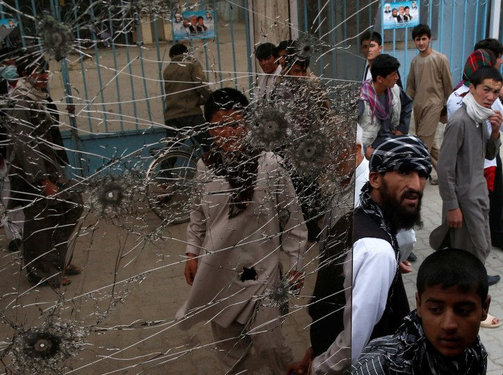 People look at a cracked side window of a bus which was damaged at bomb blasts in Kabul June 6, 2014. Abdullah Abdullah, front-runner in Afghanistan's presidential election, escaped assassination on Friday when two bombs blew up outside a hotel where he had just staged a rally, killing six people. The midday blasts, one caused by a suicide bomber, destroyed a car in Abdullah's convoy, police spokesman Hashmat Stanekzai said. One of the dead was a bodyguard. Twenty-two people were injured. (Ahmad Masood/Reuters)