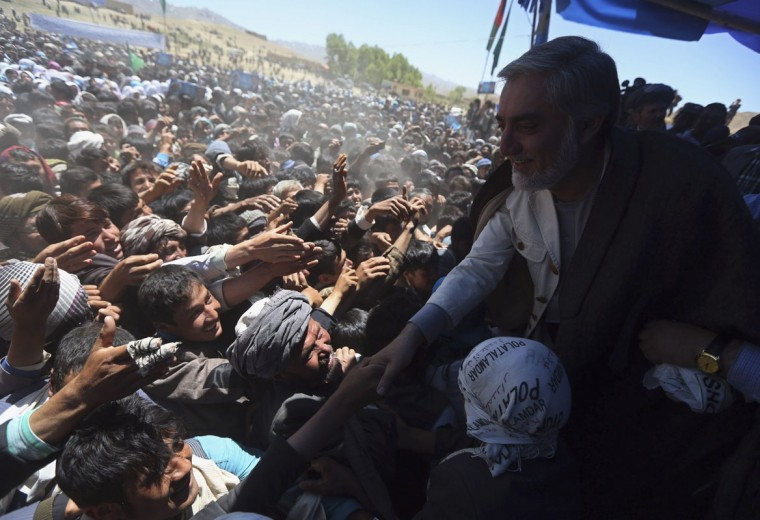 Afghan presidential candidate Abdullah Abdullah (R) shakes hands with his supporters at the second round presidential candidate election campaign gathering in Ghor province, June 10, 2014. The second round presidential election will be held on June 14. (Omar Sobhani/Reuters)