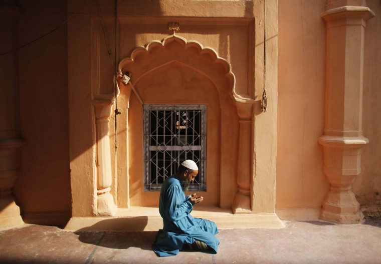 A Muslim man prays inside a mosque during the holy month of Ramadan in Old Dhaka June 30, 2014. (Andrew Biraj/Reuters)