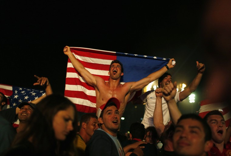 U.S. soccer fans celebrate at the end of the 2014 World Cup soccer match between U.S. and Ghana, which was broadcast on a large screen at Copacabana beach, in Rio de Janeiro.(Pilar Olivares/Reuters photo)
