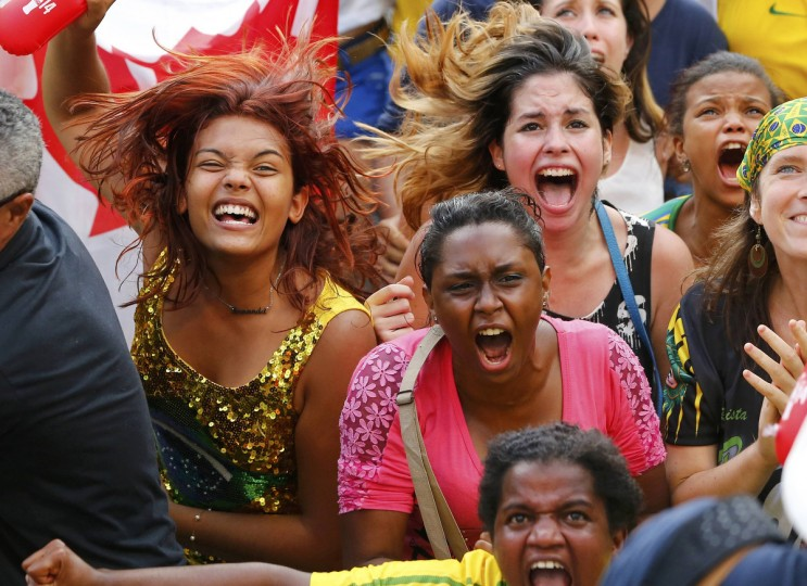 Local residents react after the 2014 World Cup round of 16 game between Brazil and Chile, in Recife June 28, 2014. (Yves Herman/Reuters)