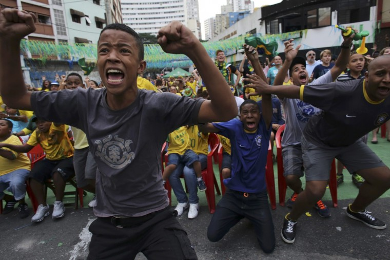 Brazilian soccer fans celebrate their victory at Bixiga neighbourhood at center of the city of Sao Paulo at the end of the 2014 World Cup round of 16 soccer match between Brazil and Chile in Belo Horizonte June 28, 2014. (Nacho Doce/Reuters)