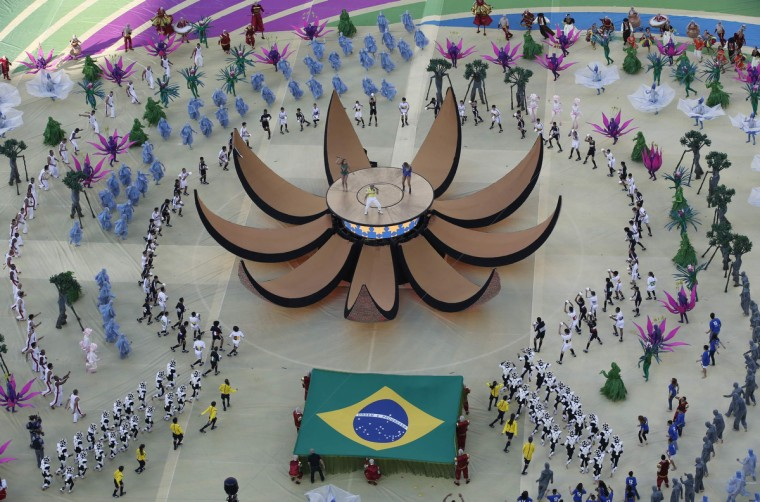 Singers Pitbull (C), Jennifer Lopez (in green) and Brazil's Claudia Leitte perform during the 2014 World Cup opening ceremony at the Corinthians arena in Sao Paulo June 12, 2014. (Fabrizio Bensch/Reuters)