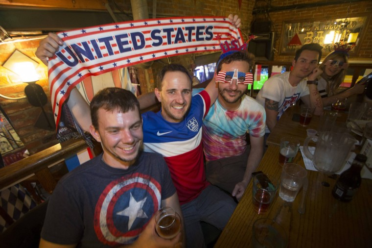 Fans pose for a photo during the 2014 Brazil World Cup Group G soccer match between Ghana and the U.S. at a viewing party at Lucky Baldwins pub in Pasadena, California. (Mario Anzuoni/Reuters photo)
