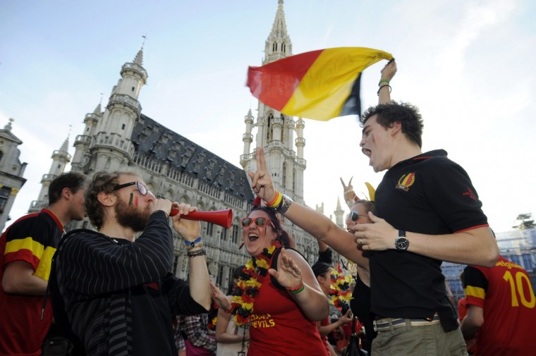 Belgian supporters celebrate the team's win over Russia in their 2014 World Cup Group H soccer match, at the Grand Place in Brussels June 22, 2014. (Eric Vidal/Reuters)