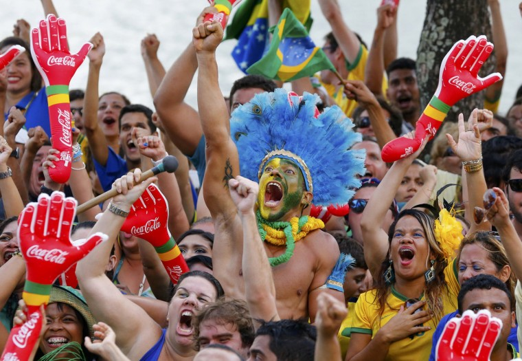 Local residents react after the 2014 World Cup round of 16 game between Brazil and Chile at the fan zone in Recife, June 28, 2014. (Yves Herman/Reuters)