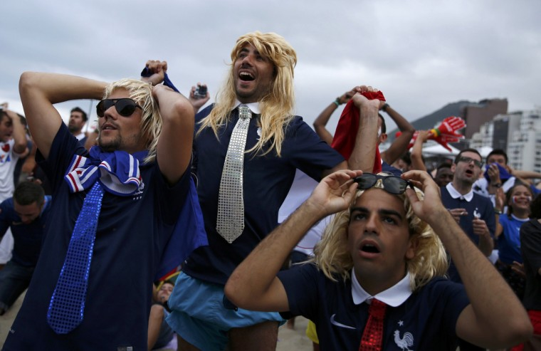 French soccer fans react as they watch the 2014 World Cup soccer match between France and Nigeria on a large screen at Copacabana beach in Rio de Janeiro, June 30, 2014. (Pilar Olivares/Reuters)