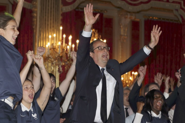 French President Francois Hollande (C) reacts as France team scores a goal against Nigeria in their 2014 World Cup round of 16 game at the Brasilia national stadium in Brasilia, at the Elysee Palace in Paris, June 30, 2014. (Philippe Wojazer/Reuters)