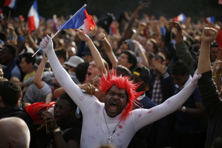 France team soccer fans wave flags as they celebrate near Paris City Hall during a live broadcast on a giant outdoor screen of the 2014 World Cup round of 16 game between France and Nigeria at the Brasilia national stadium in Brasilia, in Paris, June 30, 2014. France beat Nigeria and advances to the quarter-finals. REUTERS/Gonzalo Fuentes (FRANCE - Tags: SOCCER SPORT WORLD CUP) ORG XMIT: FAN113