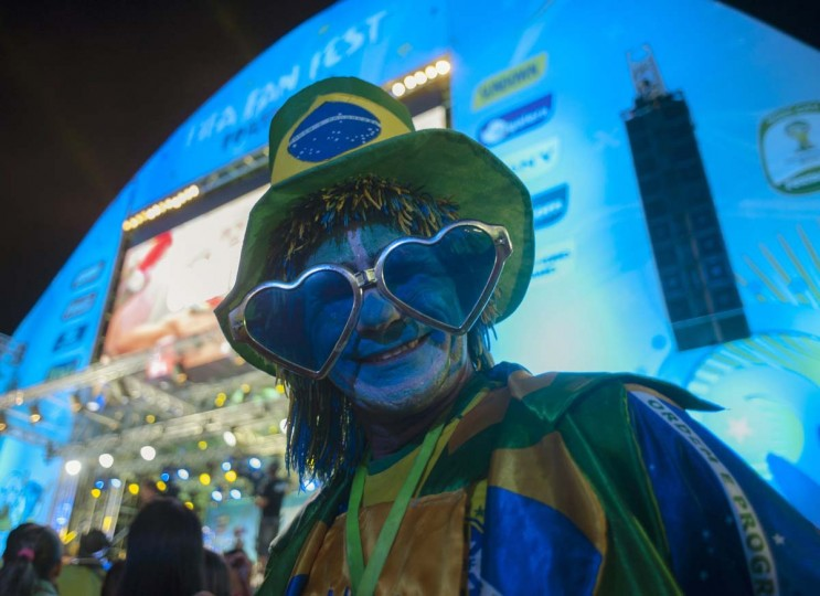A fan poses during the inauguration of the FIFA Fan Fest in Fortaleza, June 8, 2014. Fortaleza will host six soccer matches of the 2014 World Cup. Picture taken June 8, 2014. (Davi Pinheiro/Reuters)