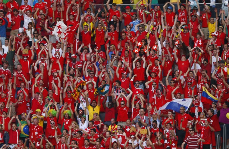 Fans of Switzerland cheer during the 2014 World Cup Group E soccer match against Ecuador at the Brasilia national stadium in Brasilia, June 15, 2014. (Eddie Keogh/Reuters)
