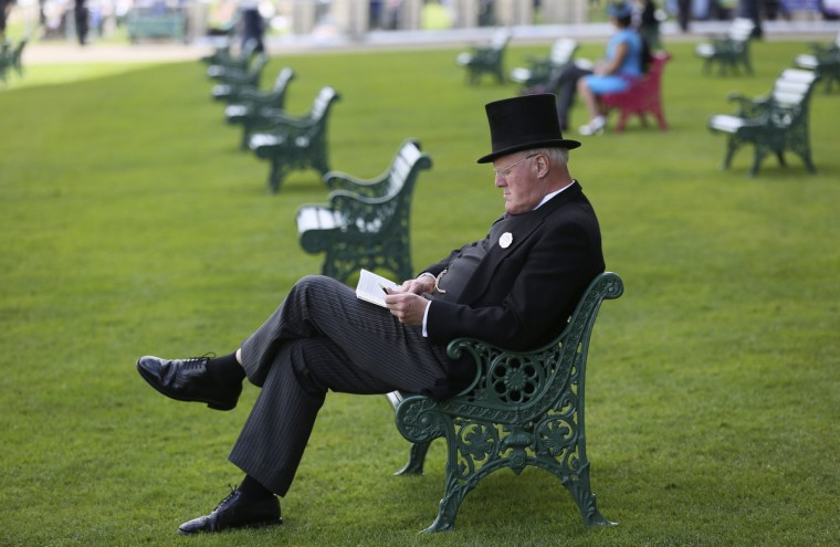 A racegoer attends the second day of the Royal Ascot horse racing festival at Ascot, southern England. (Paul Hackett/Reuters)
