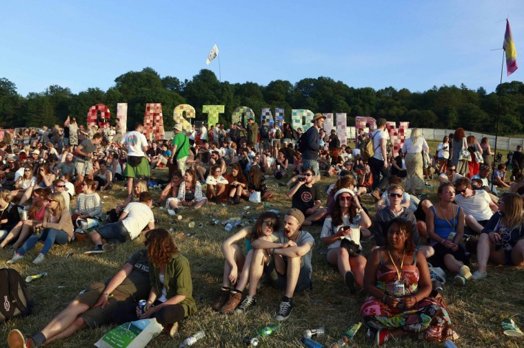 Festival goers relax at Worthy Farm in Somerset as the sun sets on the first day of the Glastonbury music festival June 25, 2014. Picture taken June 25, 2014. (Cathal McNaughton/Reuters)