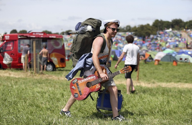 A festival goer arrives at Worthy Farm in Somerset for the first day of the Glastonbury Festival, June 25, 2014. (Cathal McNaughton/Reuters)