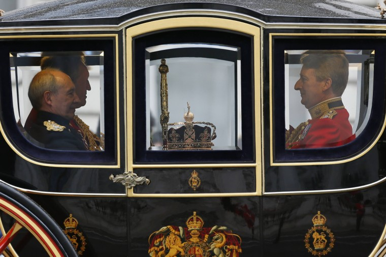 The Imperial State Crown is transported to the Palace of Westminster before the Queen's speech in the House of Lords, during the State Opening of Parliament at the Palace of Westminster in London. (Stefan Wermuth/Reuters)