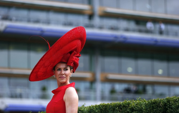 Racegoer Belinda Strudwick poses for photographers on the second day of the Royal Ascot horse racing festival at Ascot, southern England . (Suzanne Plunkett/Reuters)