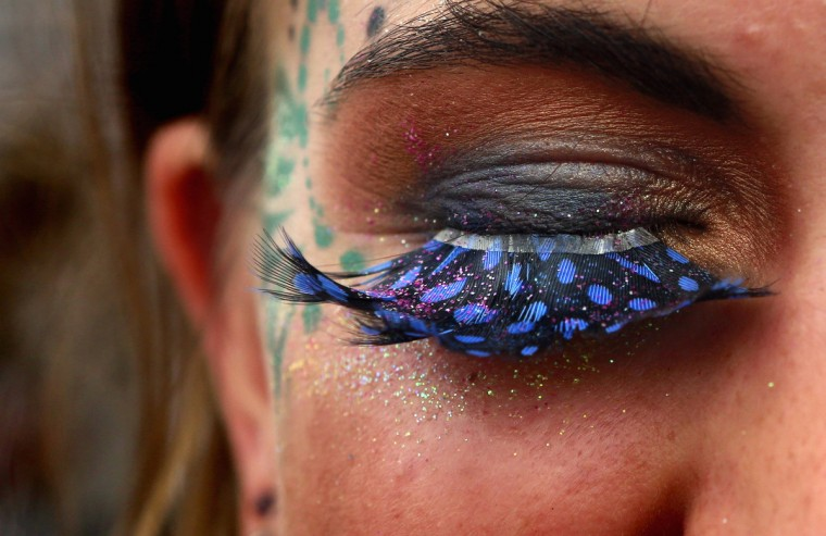A festival goer displays her false eyelashes at Worthy Farm in Somerset, on the second day of the Glastonbury music festival June 26, 2014. (Cathal McNaughton/Reuters)