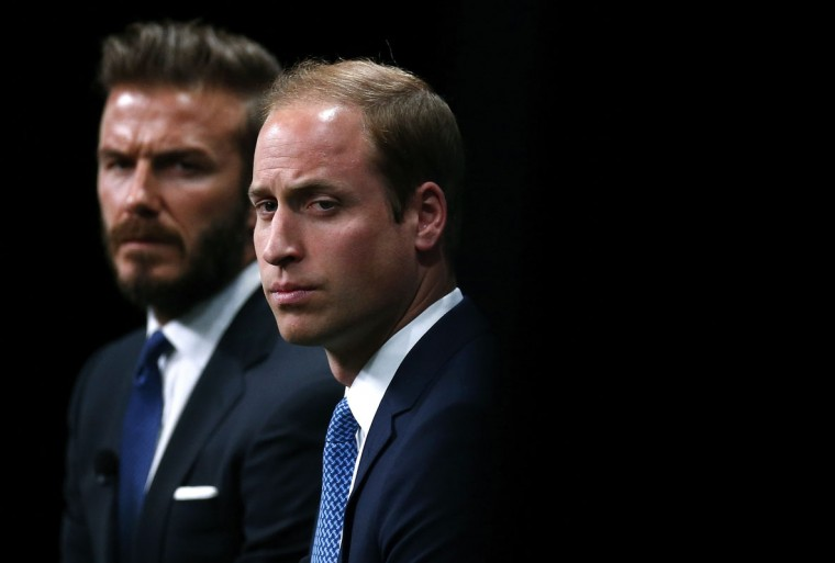 Britain's Prince William (R) and former England captain David Beckham listen to a speaker at an event to launch a wildlife conservation campaign at Google's headquarters in London June 9, 2014. (Andrew Winning/Reuters)
