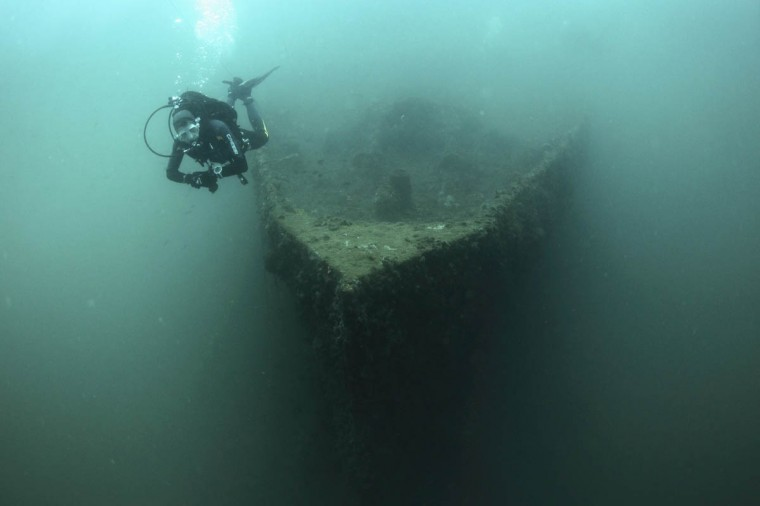 A diver swims near the bow of the wreck of the Baron Gautsch ship, near the Adriatic town of Rovinj. The 100th anniversary of the sinking of the Baron Gautsch, an Austro-Hungarian steamboat which sank in the northern Croatian Adriatic sea, will be marked on August 13, 2014. The ship, originally used to service passenger lines, had been leased by the Austro-Hungarian Army following the July 1914 outbreak of World War One to transport troops, only to run into a friendly minefield off the Brijuni islands less than a month later. Estimates say between 240 and 390 people perished in the sinking, making it one of the biggest losses of life in World War One. Today the shipwreck lies at a depth of 40 metres off the coast of Rovinj and is said to be the most popular site for divers in the Adriatic. (Antonio Bronic/Reuters photo)