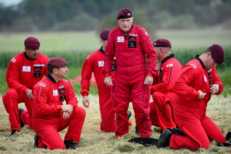 British World War II veteran Jock Hutton (C), 89, stands following his landing after he and teams of French, US, Canadian and British paratroopers jumped from aeroplanes during a D-Day commemoration in Ranville, northern France, on June 5, 2014. (Leon Neal/Getty Images)