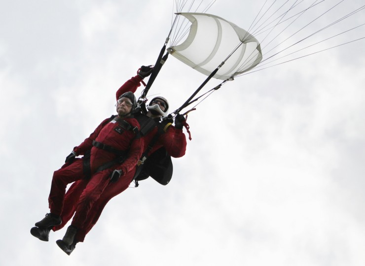 British D-Day veteran of the Normandy campaign Jock Hutton (L) arrives in tandem with a member of the British Army's Red Devils parachute team during a display in Ranville, France June 5, 2014. (Chris Helgren/Reuters)