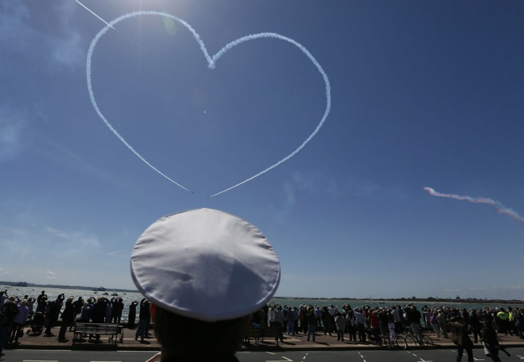 The Royal Air Force aerobatic team, the Red Arrows, perform during a D-Day event in Portsmouth June 5, 2014. Ceremonies in Portsmouth, the embarkation point of much of the invasion force in June 1944, marked the 70th Anniversary of D-Day on Thursday. (Stefan Wermuth/Reuters)