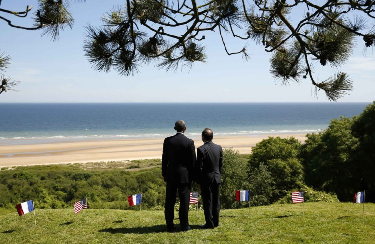 U.S. President Barack Obama (L) and French President Francois Hollande look out over Omaha Beach as they participate in the 70th French-American Commemoration D-Day Ceremony at the Normandy American Cemetery and Memorial in Colleville-sur-Mer June 6, 2014. World leaders and veterans gathered by the beaches of Normandy under clear blue skies on Friday to mark the 70th anniversary of World War Two's D-Day landings, with host France hoping the event will help bring a thaw in the Ukraine crisis. (Kevin Lamarque/Reuters)