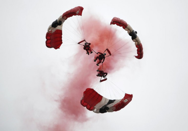 Members of the British Army's Red Devils parachute team perform a manoeuvre during a display in Ranville, France June 5, 2014. Some 3,000 veterans are among those attending ceremonies across the Normandy coastline where Allied forces landed in the largest seaborne invasion in history seventy years ago to help speed up the defeat of Nazi Germany in the Second World War. (Chris Helgren/Reuters)