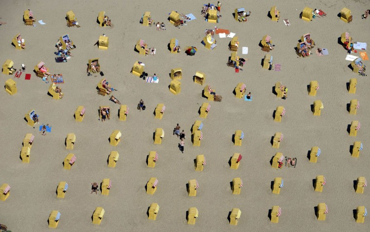 People take a sunbath in their beach chairs at a beach in Travemuende by the Baltic Sea on June 9, 2014. (Fabian Bimmer/Reuters)