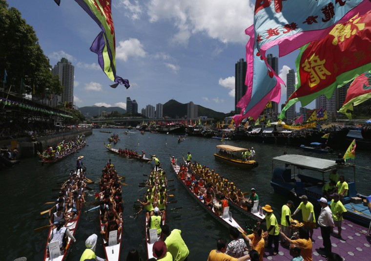 Dragon boats get together for a ceremony as part of the celebration to mark the annual Tuen Ng or Dragon Boat Festival at Hong Kong's Aberdeen June 2, 2014. The festival is commemorated in memory of Chinese patriotic poet Qu Yuan, who drowned himself on the day in 277 B.C. (Bobby Yip/Reuters)