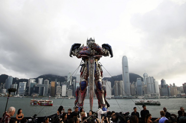 "A 21-foot tall model of the Transformers character Optimus Prime is displayed on the red carpet before the world premiere of the film ""Transformers: Age of Extinction"" in Hong Kong June 19, 2014. (Tyrone Siu/Reuters)"