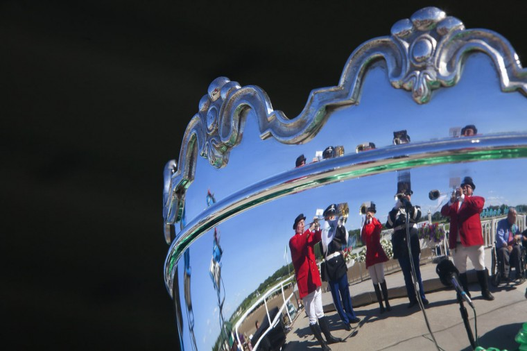 "Buglers are reflected in a trophy as they play the ""Call to Post"" before the 146th running of the Belmont Stakes in Elmont, New York June 7, 2014. California Chrome is the heavy pre-race favorite. (REUTERS/Carlo Allegri)"