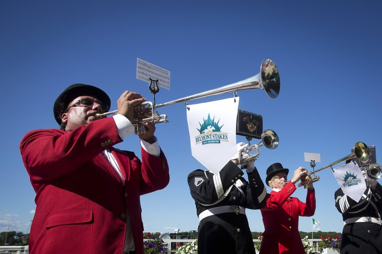 "Buglers play the ""Call to Post"" before the 146th running of the 2014 Belmont Stakes in Elmont, New York June 7, 2014. California Chrome is the heavy pre-race favorite. (REUTERS/Carlo Allegri)"