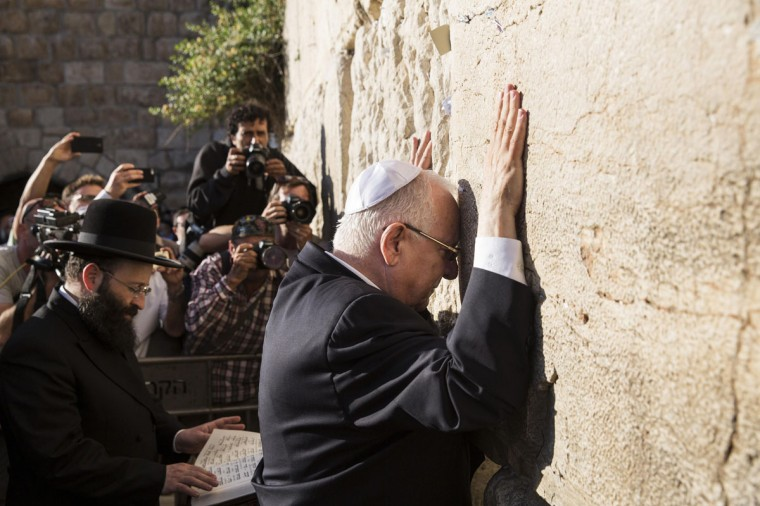 Reuven Rivlin, a former speaker of parliament touches the stones of the Western Wall, Judaism's holiest prayer site, in Jerusalem's Old City, after he was elected Israel's president June 10, 2014. Rivlin, a right-wing legislator opposed to the creation of a Palestinian state, was elected Israel's president on Tuesday and will replace the dovish Shimon Peres in the largely ceremonial post. (Baz Ratner/Reuters)
