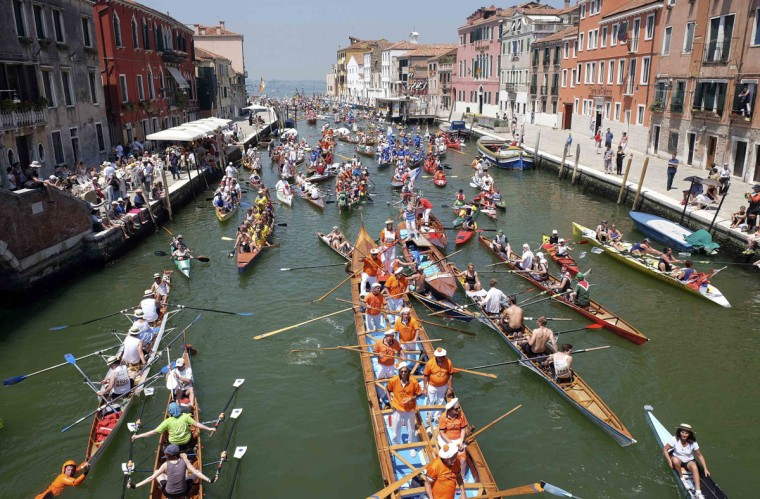Rowers arrive in the Gran Canal as they take part in the Vogalonga, or Long Row, in the Venice lagoon June 8, 2014. The annual boating event features a 30 km (18.6 miles) course starting at St. Mark's Square. (Manuel Silvestri /Reuters)