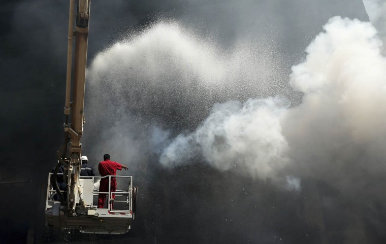Firefighters work to extinguish a blaze at a carpet market in Benghazi. According to local authorities, no casualties were reported in the fire which started in a fireworks shop close to the market. (Esam Omran Al-Fetori/Reuters photo)
