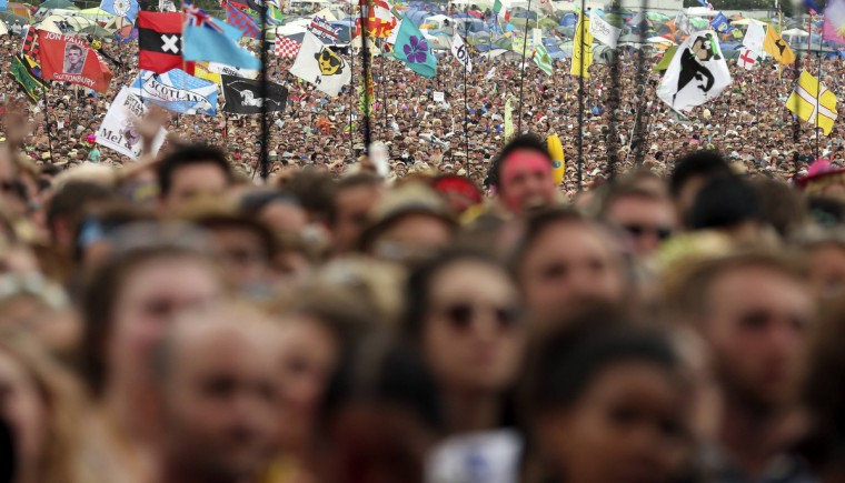 Festival goers watch American country music star Dolly Parton perform on the Pyramid Stage at Worthy Farm in Somerset, during the Glastonbury Festival June 29, 2014. (Cathal McNaughton/Reuters)