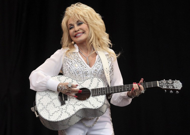 American country music star Dolly Parton performs on the Pyramid Stage at Worthy Farm in Somerset, during the Glastonbury Festival June 29, 2014. (Cathal McNaughton/Reuters)