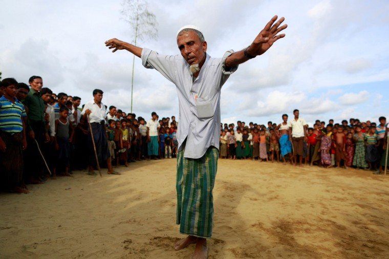 A Rohingya Muslim man performs a dance before the start of a fight as part of a traditional wrestling festival at Kyaukpannu village in Maungdaw, northern Rakhine state June 6, 2014. Rohingya Muslim men and children took part in the festival in western Myanmar's Rakhine State, where the majority of an estimated 1.3 million stateless Muslim Rohingyas live in. (Soe Zeya Tun/Reuters)