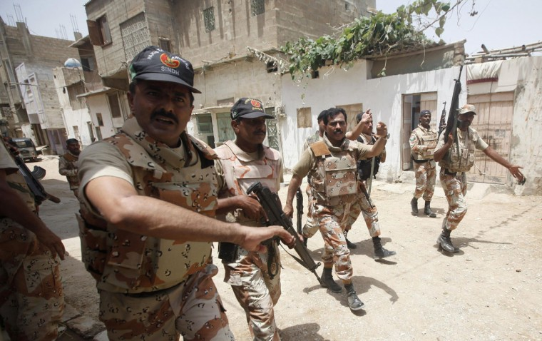 Paramilitary soldiers react as they ask members of the media to leave during their search in a neighbourhood, after a gunfire attack on a security academy run by the Airports Security Force (ASF) in Karachi June 10, 2014. Pakistan's Taliban insurgents claimed responsibility for the attack on the security academy at Karachi's airport on Tuesday, less than 48 hours after an all-night siege by Taliban gunmen at Pakistan's busiest airport that killed more than 30 people. (Athar Hussain/Reuters)