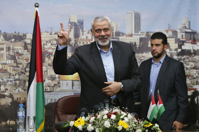 Senior Hamas leader Ismail Haniyeh gestures before delivering a farewell speech for his former position as a Hamas government Prime Minister, in Gaza City June 2, 2014. Palestinian President Mahmoud Abbas swore in a unity government on Monday after overcoming a last-minute dispute with the Hamas Islamist group. (Suhaib Salem/Reuters)