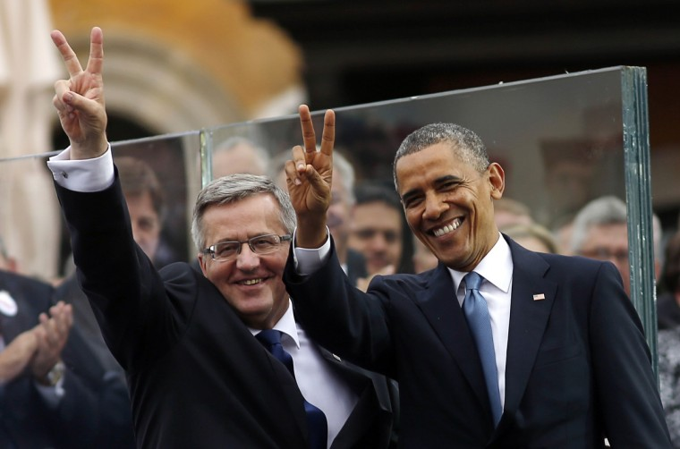 U.S President Barack Obama and Polish President Bronislaw Komorowski gesture at a Freedom Day event at Royal Square in Warsaw. The event marks the 25th anniversary of Poland's first partially-free election since Moscow imposed communism after World War Two. (Kevin Lamarque/Reuters)