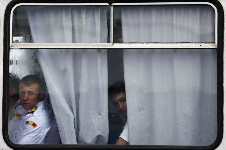Romanian soldiers look out from a bus after the welcoming ceremony for U.S. Defense Secretary Chuck Hagel in the Black Sea port of Constanta June 5, 2014. Hagel will visit the U.S. cruiser Vella Gulf on rotational duty in the Black Sea, before making his way to Normandy to commemorate the 70th anniversary of the D-Day invasion. (Bogdan Cristel/Reuters)