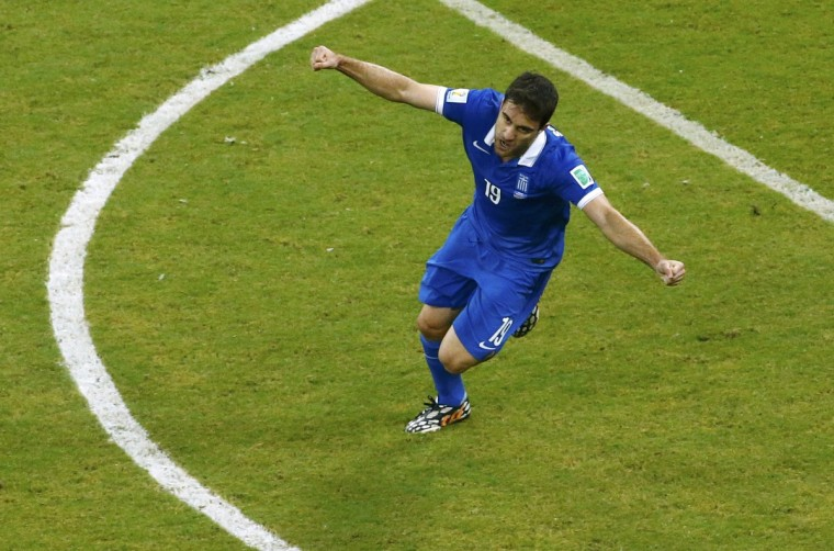 Greece's Sokratis Papastathopoulos celebrates after scoring a goal during the 2014 World Cup round of 16 game between Costa Rica and Greece at the Pernambuco arena in Recife June 29, 2014. (Ruben Sprich/Reuters)