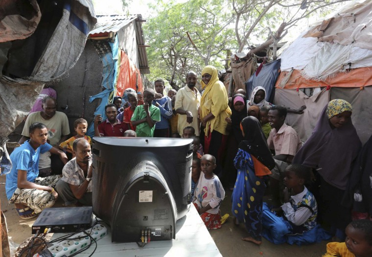 Internally displaced Somali people crowd around a television set to watch the World Cup in Brazil highlights, in the capital Mogadishu June 12, 2014. (Feisal Omar/Reuters)