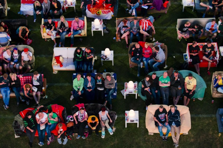 People sit on sofas as they watch the opening game of the 2014 World cup between Brazil and Croatia, during a public viewing event at the Alte Foersterei stadium in Berlin June 12, 2014. Berlin's Union soccer club has invited its supporters to bring their sofas to its stadium to watch World Cup soccer matches on a giant screen in a communal living room atmosphere. (Thomas Pete/Reuters)