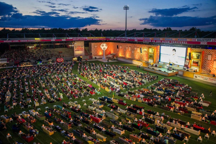 People sit on sofas as they watch the opening game of the 2014 World Cup between Brazil and Croatia, during a public viewing event at the Alte Foersterei stadium in Berlin June 12, 2014. Berlin's Union soccer club has invited its supporters to bring their sofas to its stadium to watch World Cup soccer matches on a giant screen in a communal living room atmosphere. (Thomas Peter/Reuters)