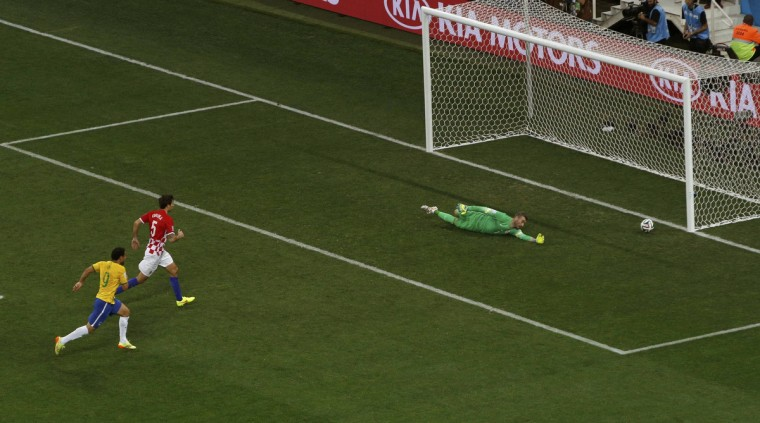 Croatia's goalkeeper Stipe Pletikosa fails to save the goal scored by Brazil's Neymar (unseen) during the 2014 World Cup opening match at the Corinthians arena in Sao Paulo June 12, 2014. (Paulo Whitaker/Reuters)