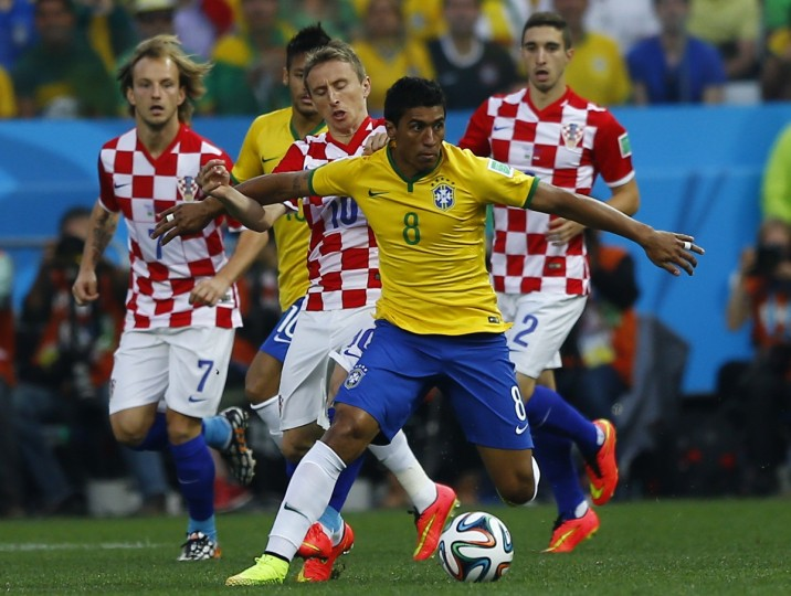 (L-R) Croatia's Ivan Rakitic, Croatia's Luka Modric, Brazil's Paulinho and Croatia's Sime Vrsaljko fight for the ball during the 2014 World Cup opening match at the Corinthians arena in Sao Paulo June 12, 2014. (Ivan Alvarado/Reuters)